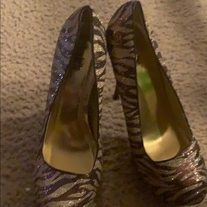 Brown and sliver gently used heels